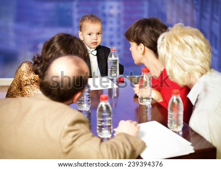 Business meeting at the head table young businessman - stock photo