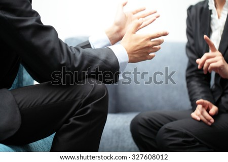 Business Meeting Discussion Between Two People in Suit - stock photo