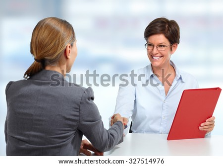 Business meeting. Group of women working with papers. - stock photo