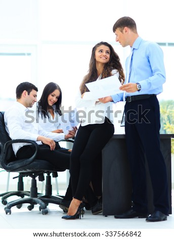 Business - meeting in office, two managers are discussing a document - stock photo