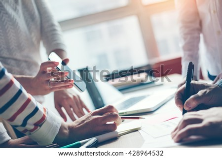 Business meeting. Marketing strategy brainstorming. Paperwork and digital in open space. - stock photo
