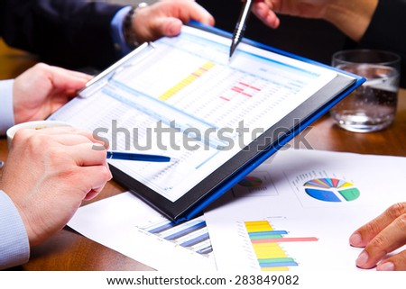 business Meeting on chart - stock photo