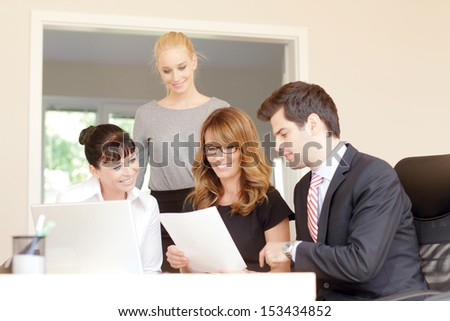 Business meeting. Portrait of friendly professional business team smiling at the camera. - stock photo