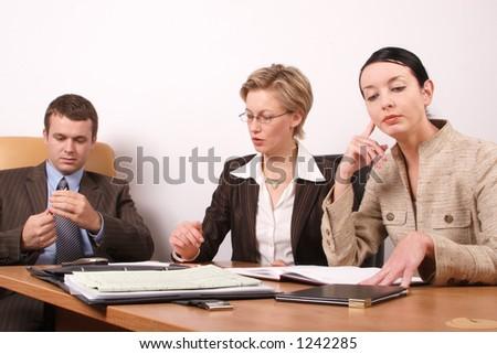 Business meeting preparing  - 2 woman, 1 man - stock photo