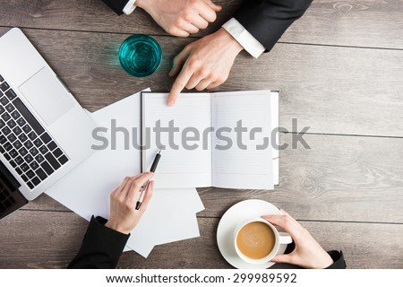 business meeting. Signing of important papers. Top view.  empty white space you can put your text - stock photo