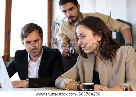 Business meeting team analyzes results