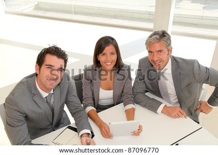Business meeting with electronic tablet - stock photo