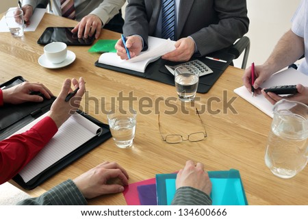 Business meeting with people working as a team in the office - stock photo