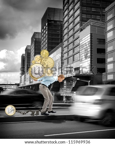 Business men carrying coins on his back - stock photo
