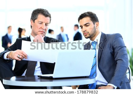 Business men discussing together in an office - stock photo