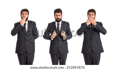 Business men doing surprise gesture over white background - stock photo