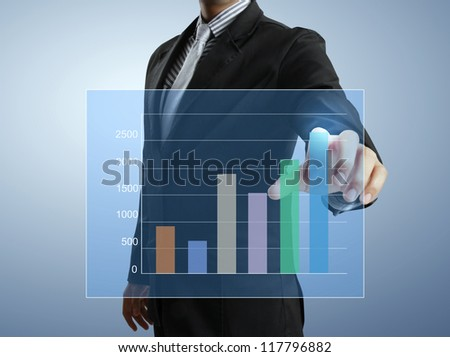 Business men hand pushing write graph - stock photo