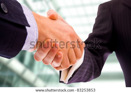 Business men hand shake at the office - stock photo