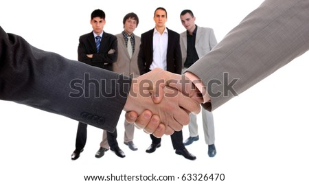 Business men hand shake with team on background - stock photo