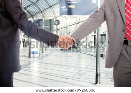 business men handshake at office building - stock photo