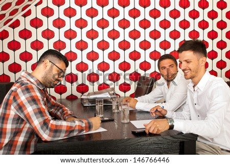 Business men having conversation at meeting in a modern room - stock photo