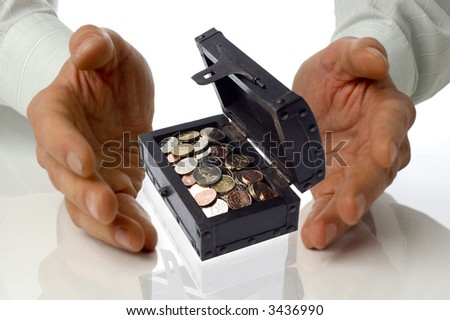 business men holding a treasure box between hands on white - stock photo