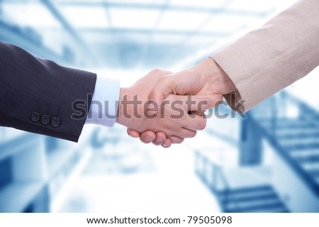 Business men in a handshake at the office