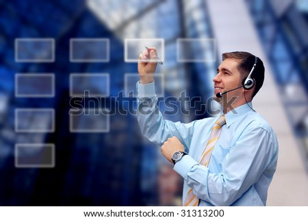 Business men in headphones writing on business architecture background - stock photo
