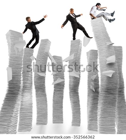 Business men of unstable piles of paper - stock photo