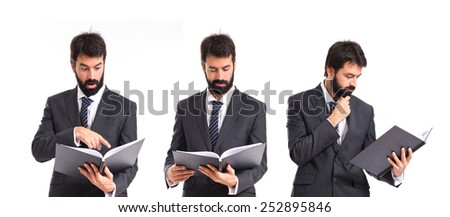 Business men reading a book over white background
