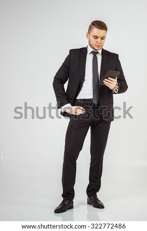 Business men standing and working with tablet, isolated - stock photo