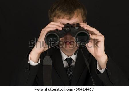 Business men with binoculars - stock photo