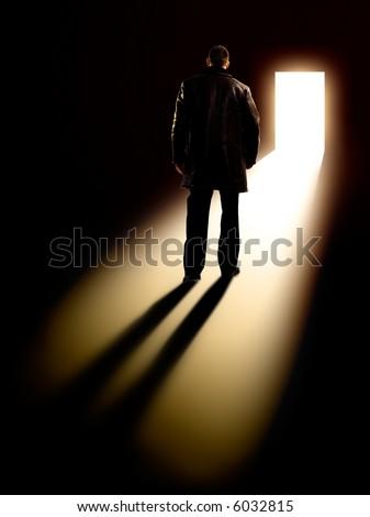 Business Metaphor - businessman walking towards door - stock photo
