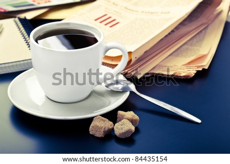 Business morning, coffee and newspaper - stock photo