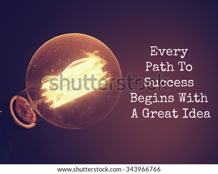 Business motivational quote of Every Path To Success Begins With A Great Idea ,on dark background with retro light bulb is glowing. Message for your design or inspirational poster. - stock photo