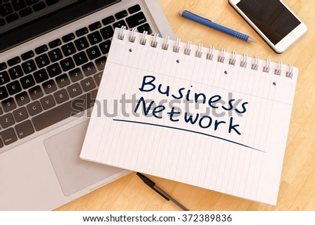 Business Network - handwritten text in a notebook on a desk - 3d render illustration. - stock photo