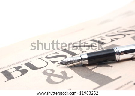 Business newspaper with a pen