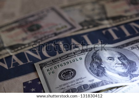 Business newspaper with money