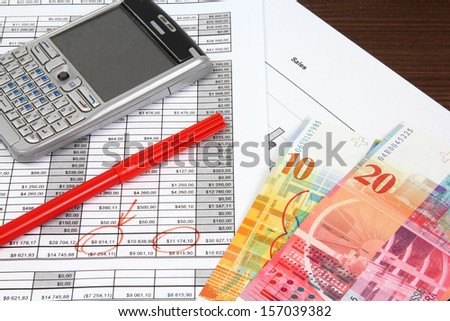 Business objects. Financial analysis - income statement, finance graphs, generic smart phone and Swiss franc currency. - stock photo
