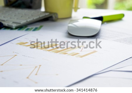Business of financial analytics desktop with accounting charts and diagrams - stock photo