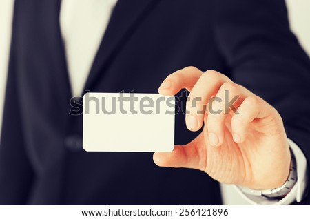 business, office, advertisement concept - businessman showing blank card - stock photo