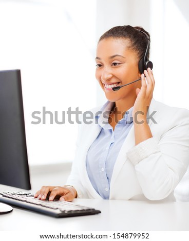 business, office and communication concept - african female helpline operator with headphones - stock photo