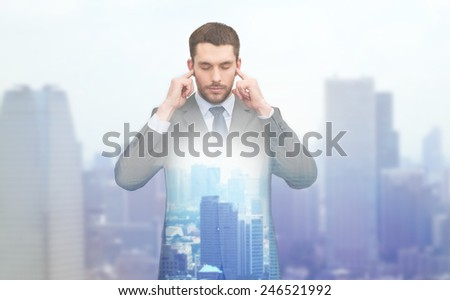 business, office and education concept - double exposure of annoyed businessman covering his ears with his hands and city background - stock photo