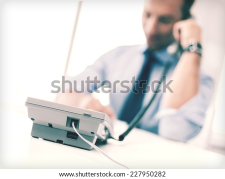 business, office, school and education concept - businessman talking on the phone - stock photo