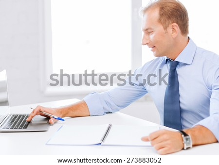 business, office, school and education concept - smiling businessman working in office - stock photo