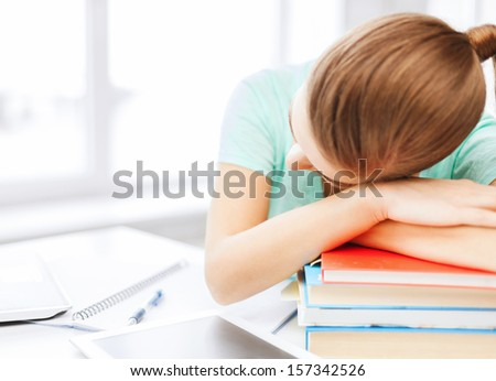 business, office, school and education concept - tired student sleeping on stock of books - stock photo