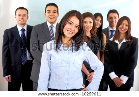 business office team smiling with a woman leading it - stock photo