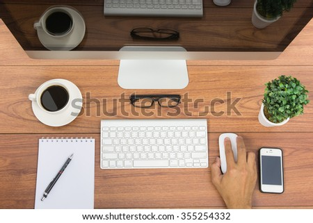 Business office top view computer monitor on wooden table - stock photo