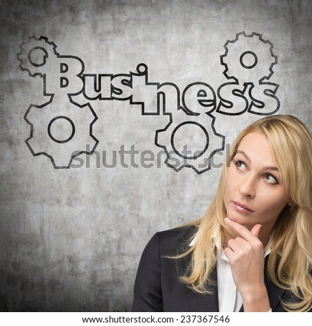 business on the wall near a woman - stock photo
