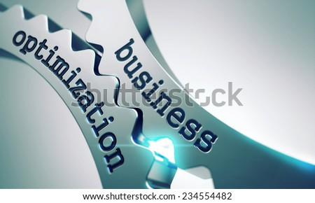 Business Optimization on Gears Mechanism on a Gray Background. - stock photo