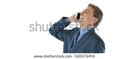 Business or sales man on the phone laughing with his clients
