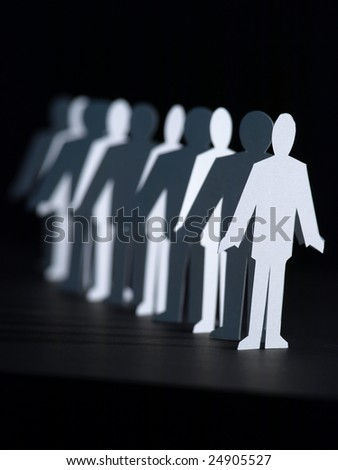 Business Paper Dolls in line on black