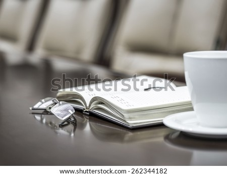 Business papers in conference room before meeting in office - stock photo
