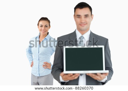 Business partner presenting laptop against a white background