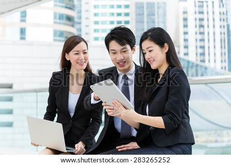Business partner work together with laptop computer and tablet at outdoor - stock photo